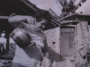 Mrs. Maria Celeste putting hot water over the ashes